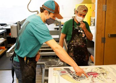 Tamarind Student Printer Austin Armstrong with Tipping Points artist Eric Garcia