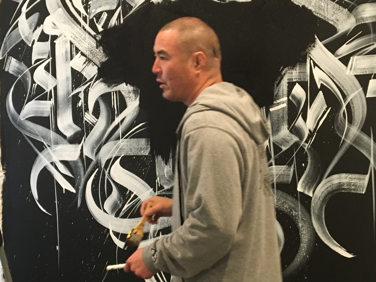 DEFER in front of mural