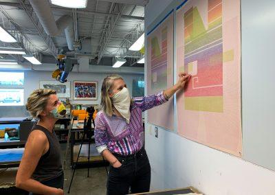 Alyssa Ebinger and Ellen Lesperance evaluate a proof.