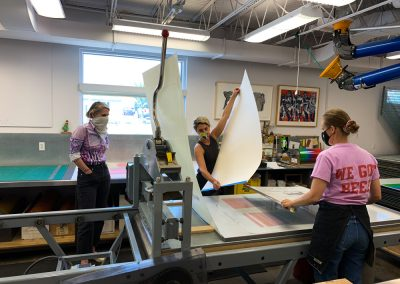 Ellen Lesperance, Alyssa Ebinger and Valpuri Remling in the workshop.