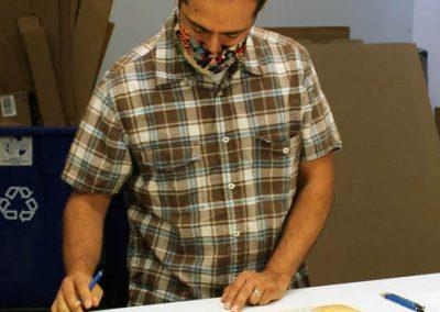 Tipping Points artist Eric Garcia signing prints