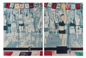 Diptych by Stella Ebner with a row of red, black, and green rectangular yoga mats in the foreground. To the left, a figure wearing black shorts and a sports bra faces forward. The figure stands in a variation of dancer pose with their right arm pulling back the bent right leg and raises the left arm vertically. In the background, rows of people in monochrome cool gray tones hold variations of their teacher's pose.