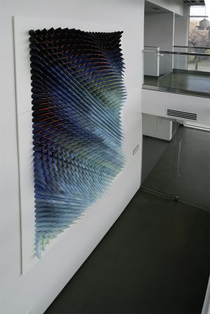 Three-dimensional, six-color lithographic monoprint collage by Matthew Shlian.